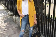 blue ripped skinnies, a white t-shirt, a sunny yellow oversized blazer, black shoes and a bag