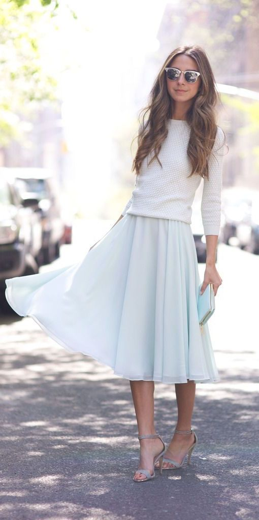a textural white top, a light blue midi skirt, a light blue clutch and grey ankle strap shoes