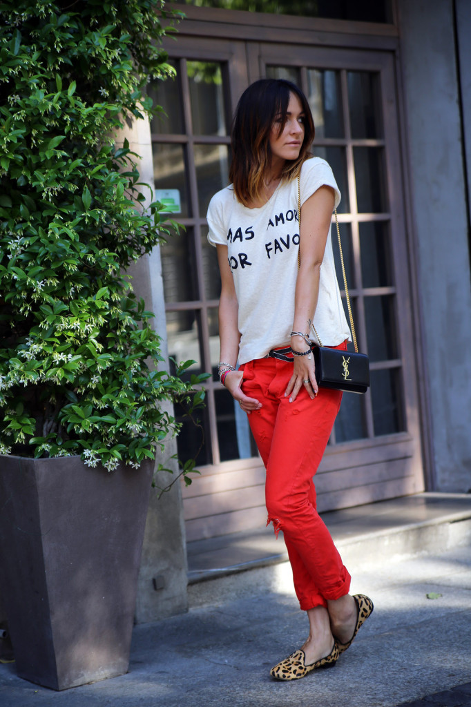 a colorful spring look with a printed tee, red pants, leopard print flats and a black crossbody
