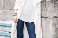 a spring outfit with navy straight jeans, a white top, nude shoes and white trench