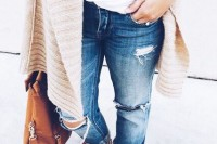 blue ripped straight jeans, a white top, nude strappy sandals, a neutrla cardigan and a brown bag