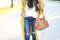navy ripped skinnies, a white top, a long mustard cardigan, brown booties, a brown tote