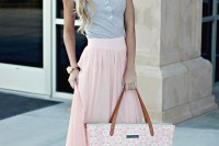 a grey button up top, a pink maxi skirt, a printed pink tote is a romantic look or every day
