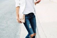 a casual spring look with navy ripped jeans, a white top, a white blazer, metallic shoes and a neutral clutch
