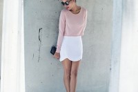 a spring to summer look with a blush top, a white scallop edge mini, white heels and a black clutch