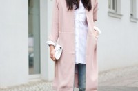 an oversized white shirt, blue ripped jeans, a long blush blazer, a white hat and nude shoes