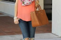 a bright spring outfit with a coral top, a floral scarf, navy ripped jeans, nude shoes and a brown bag