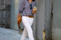 a checked shirt, white jeans, brown shoes with block heels and a belt plsu a brown clutch