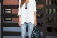 a white top, a white blazer, blue ripped jeans, a teal bag and black heels for a spring to summer look