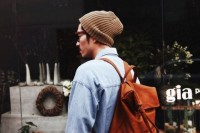 a classic brown leather backpack is a cool accessory for many looks and its neutral color will help it fit