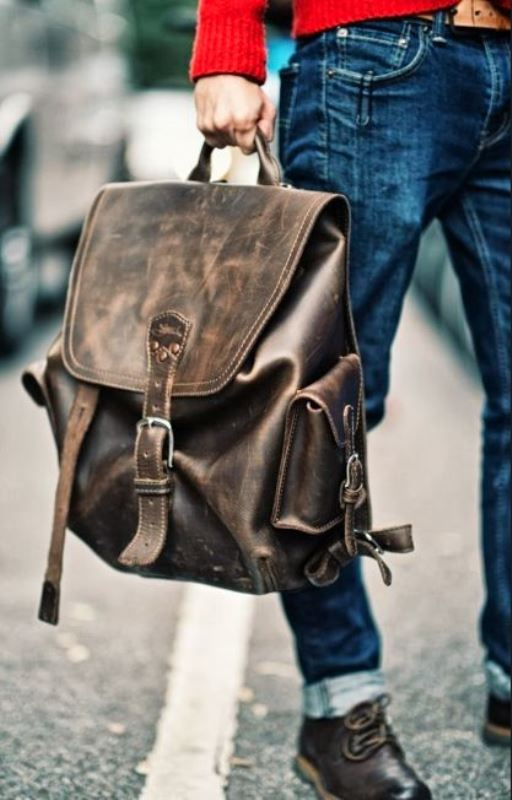 a dark leather backpack with a vintage feel is a stylish bag idea to rock anytime