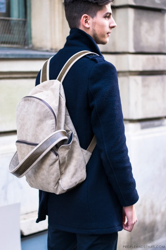 a chic modern neutral backpack with brown straps is a stylish and very contemproary accessory