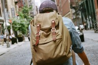 a neutral fabric backpack and faux brown leather is a cool idea for any time, it's eco-friendly