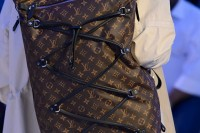 a trendy LV backpack with its traditional print, lacing up and a black top is super stylish