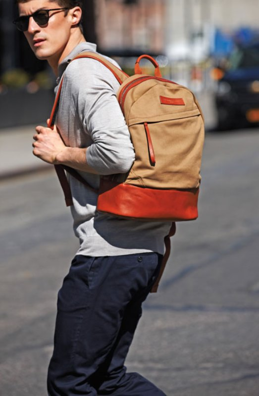 a chic tan and amber backpack of leather and fabric is a cool accent for your look