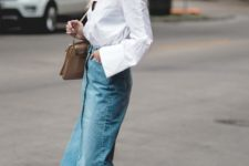 a chic outfit with a blue denim midi, a white shirt, brown strap up shoes and a brown bag