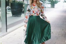 a floral long sleeve top, a green plated midi skirt, nude shoes and a white bag for a cool spring feel