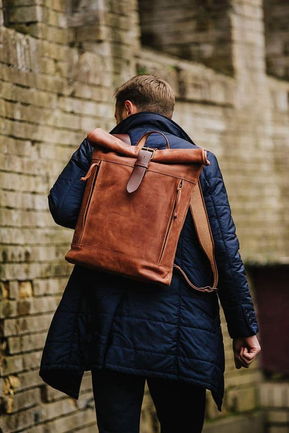 a quirky brown leather backpack with zip compartments and brown straps is very eye-catchy