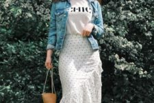 a spring to summer look with a printed tee, a polka dot ruffle midi, white shoes, a basket bag and a denim jacket