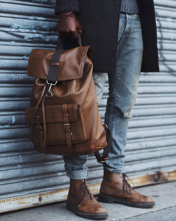 a stylish brown leather backpack with dark straps is a cool choice for many looks