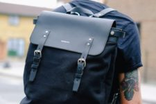 a stylish modern black backpack of leather and suede looks very masculine and makes a brutal statement