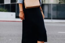 a tee, a blue denim jacket, a black midi skirt, tan sneakers and a blush crossbody for spring