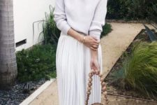 a white otufit with a top, a plated midi skirt, nude shoes and a wooden and wood bead bag