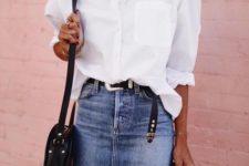 a white oversized shirt, a blue denim mini, a black crossbody bag and a black belt to match