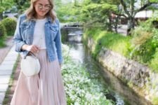 a white tee, a blush pleated midi, blush strappy shoes, a white round bag and a blue denim jacket