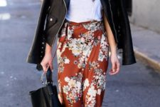 a white tee, a florla midi skirt, a black leather jacket, a black tote and black strappy shoes