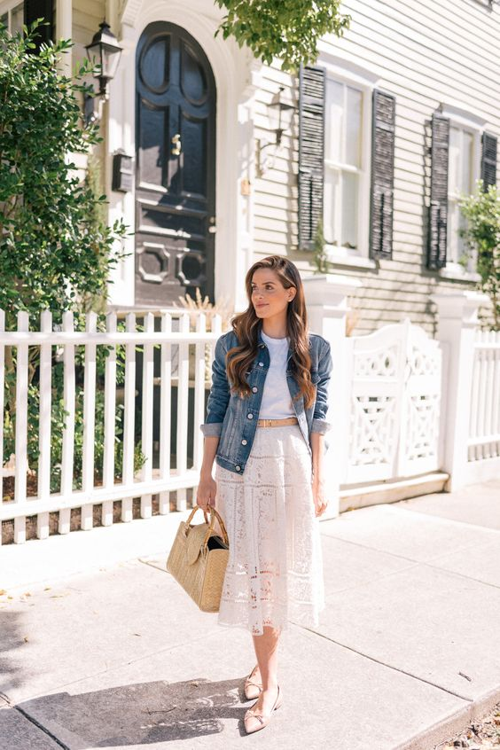 a white top, a white lace midi skirt, a denim jacket, blush flats and a neutral bag