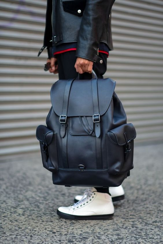 an oversized black leather backpack with pockets and straps is always a stylish idea