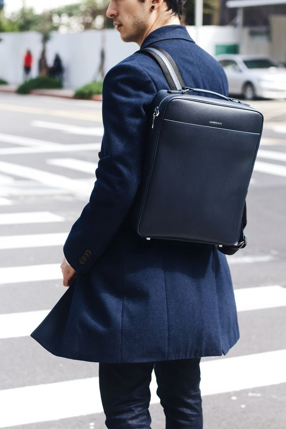 an super minimalist navy backpack is a cool accessory to rock with any ultra modern look