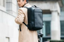 an ultra-minimalist black leather backpack is a cool accessory for modern outfits
