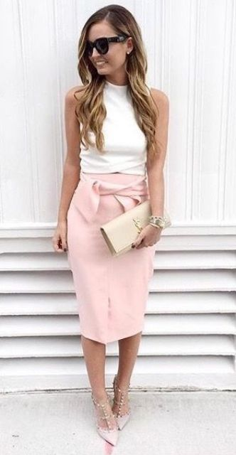a sexy outfit with a white turtleneck sleeveless top, a pink pencil midi with a bow, a nude clutch and blush spiked shoes