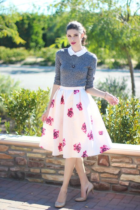 a grey top over a white shirt, a bright floral A-line midi skirt, nude shoes for a retro-infused spring outfit