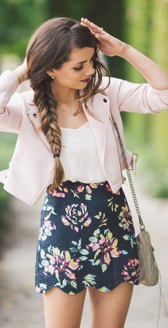 a romantic spring look with a white top, a dark floral skirt, a pink leather jacket, a neutral bag