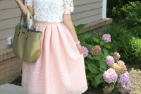 a white lace crop top, a pink full perforated skirt, pink shoes and a green tote for a feminine spring look