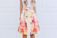 a simple outfit with a white t-shirt, a bright watercolor print skirt, blush shoes always works