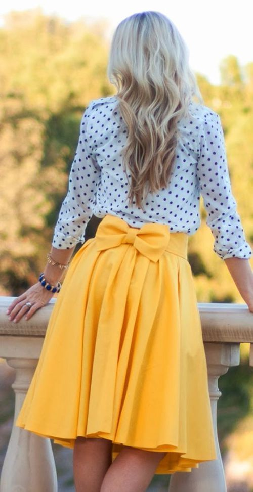 a simple spring outfit with a polka dot shirt and a sunny yellow pleated A-line skirt with a bow on the back