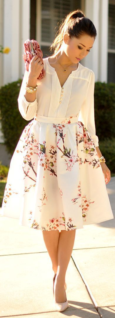 a romantic spring outfit with a white shirt, a floral A-line midi skirt, nude shoes and a pink rose clutch