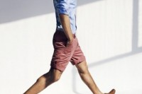 a blue shirt with cuffed sleeves, coral shorts and mustard suede moccasins for a relaxed look on a hot day