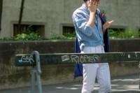 a chambray shirt, white pants, a bold blue blazer and brown moccasins plus colorful socks
