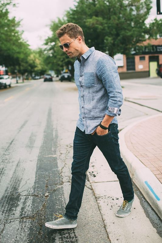 a chambray shirt, navy jeans, grey sneakers for a relaxed double denim look