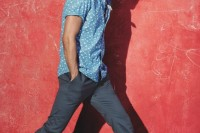 a light blue short sleeve shirt, grey pants, neutral shoes for a cool and stylish summer look