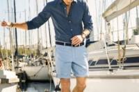 a navy long sleeve shirt, blue shorts for a coastal or beach look