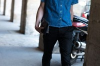 a denim cropped short sleeve shirt, black pants and black sneakers for a trendy summer look