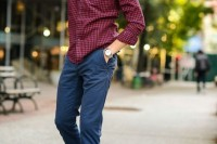 a burgundy plaid shirt, navy pants, two tone brogues for a stylish and bold look