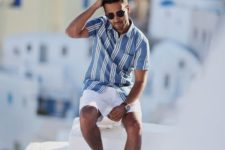a blue striped short sleeve shirt, white shorts, white sneakers are a classic coastal look