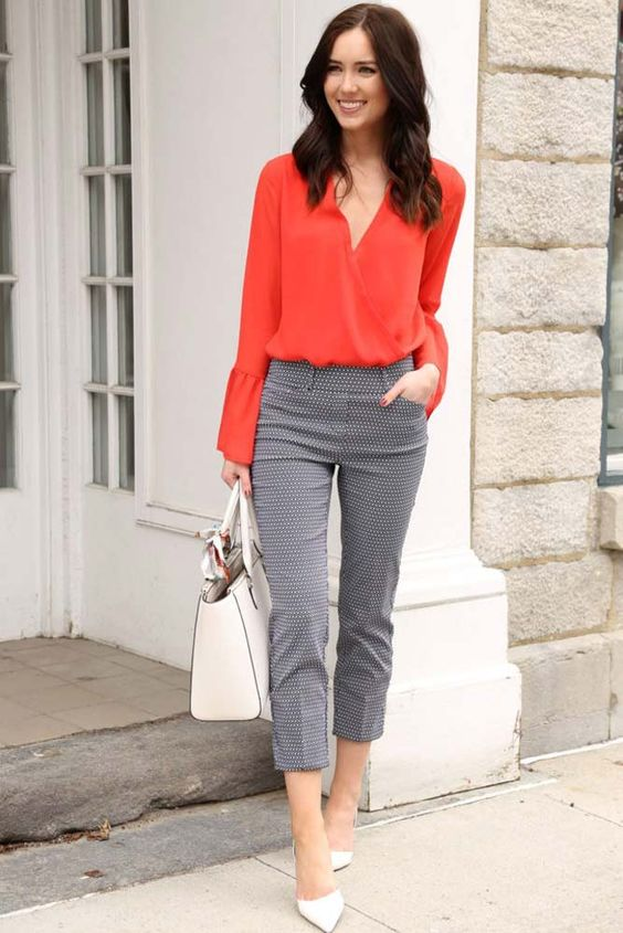 a bright spring work look with a fiery red blouse, printed cropped pants, white shoes and a large bag